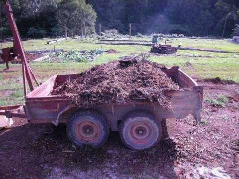 a trailer full of wood chips
