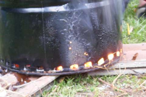 6. biochar making Closeup of secondary air biochar making on a budget with charmaster dolph