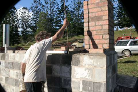 Charmaster Dolph Cooke working on Adam retort biochar kiln at Kunghur