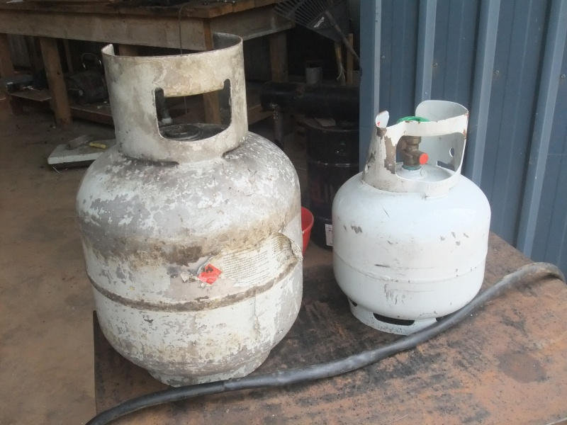 LPG gas bottles from Australia being thrown out