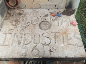 picture ontop of the fire box with the words biochar industries written in cement