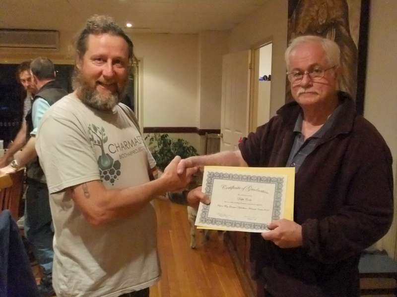 Charmaster Dolph Cooke accepting the advanced course certificate in Quantum agriculture from Hugh Lovell. Holistic land management approcah