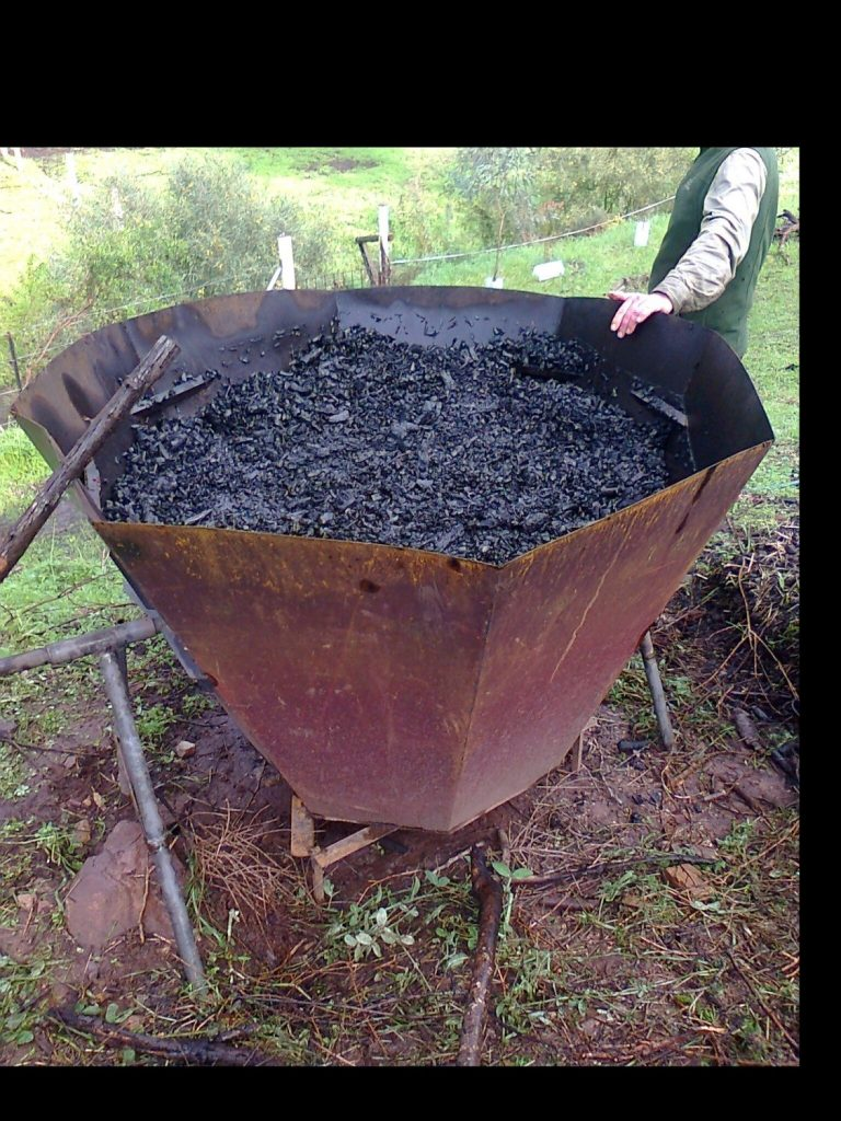 full of biochar Kontiki Cone kiln by Michael Williams.